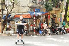 Noodle soup shop owner makes deliveries on hoverboard