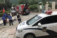 Mưa lớn sập đường ở Bắc Kinh, nhiều người thiệt mạng