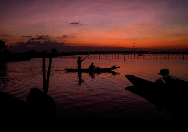 Tranquil village by largest brackish lagoon in Southeast Asia