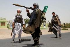 Thế giới 7 ngày: Taliban khôi phục hình phạt tàn khốc, Triều Tiên duyệt binh, thử tên lửa