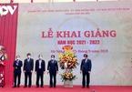 Vietnamese students begin new school year in person, online