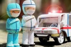Người phụ nữ dựng mô hình y bác sĩ chống dịch từ giấy Kami