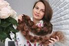 Cô gái Ukraine có mái tóc dài 1,67 m, không cắt trong 26 năm